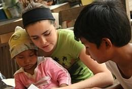 A professional occupational therapy volunteer works with children at her placement in Cambodia.