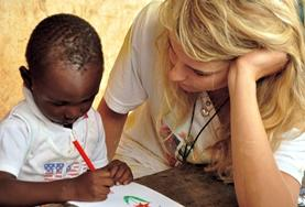 A professional volunteer occupational therapist gives children in Ghana a creative activity to complete as part of their treatment.