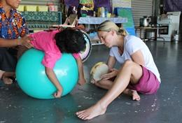 A professional occupational therapist volunteering in Samoa treats a child