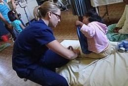 A physical therapist works with a child at a Bolivian hospital.