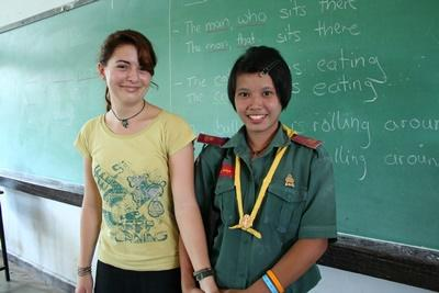 Professional volunteer with student on teaching project in Thailand