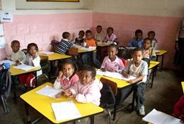 Children participate in an English class taught by a professional teacher volunteering in Ethiopia.