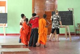 A professional teacher volunteering in Sri Lanka teaches an English class for local children.