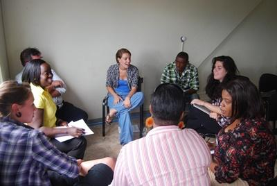 Professional volunteer leading a literacy class in Jamaica