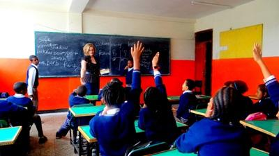 Female volunteer busy in a teaching project in Ethiopia