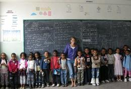 A science teacher volunteering in Ethiopia with her youngest students at a local school.