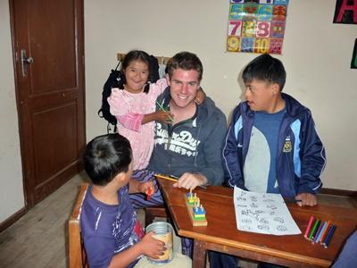 Professional volunteer with students on Special Education project in Bolivia