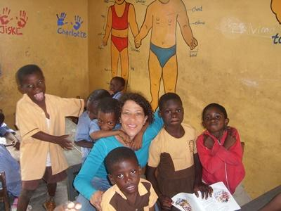 Professional volunteer with students on special education project in Ghana