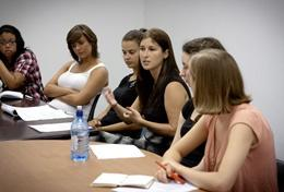 Professional law and human rights volunteers discuss a case during a meeting.