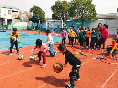 Children in China develop their ball skills on the after school sports volunteer project