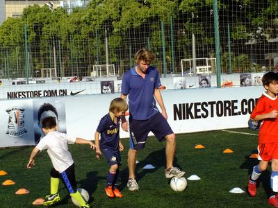 A volunteer coaches soccer on the after school sports volunteer project in China