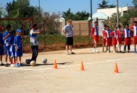 Children practice soccer drills after school with the volunteer coach in Morocco.