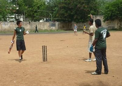Gap Year volunteer coaches a cricket team at a school in India