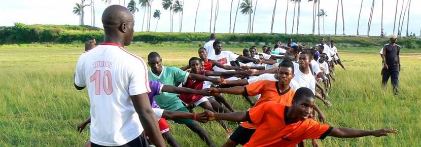School rugby practice with volunteer coach in Ghana