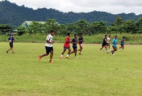 A volunteer supervises fitness training for a local rugby team in Samoa.