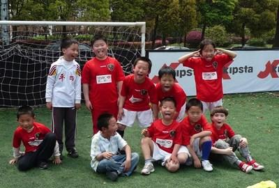 Soccer team coached by volunteer at a school in China