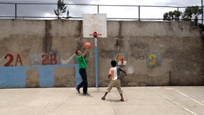 An Ethiopian child plays a game of basketball with a Projects Abroad volunteer.