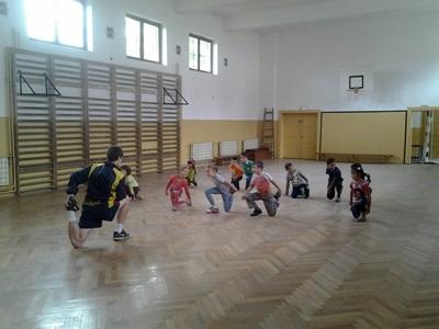 A group of Romanian children participate in a PE class led by a volunteer.