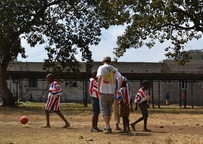 Sports volunteer coaches school children in Tanzania