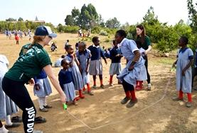 Volunteers coach soccer to a school team during physical education classes in Kenya.