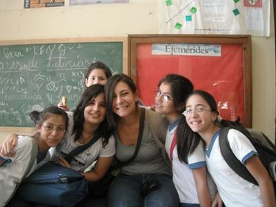 A Projects Abroad Teaching volunteer poses for a photo with secondary school students in Argentina.