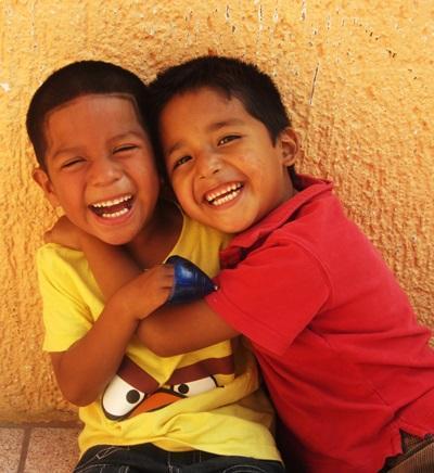 Male school children in Belize enjoy afternoon playtime