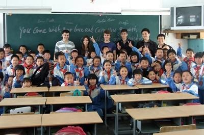 Volunteers with their class at a school in China on the Teaching project