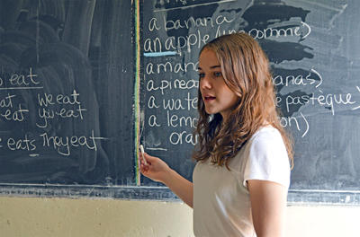 Volunteer teaches French in a school in Ethiopia on the Teaching project