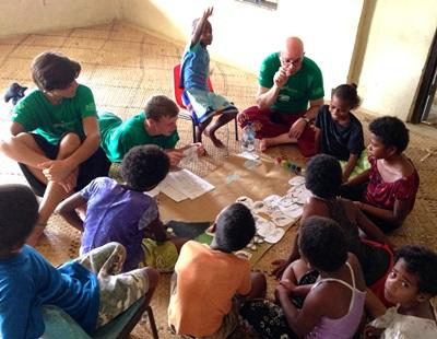Fijian students learn about sharks from a group of Projects Abroad volunteers