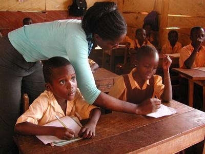 Students take notes during a lesson with Teaching volunteer in a school in Ghana