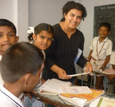 Volunteer helping kids with classwork on the Teaching project in a school in India