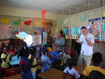 Volunteers lead a class on the teaching project in a school in Jamaica