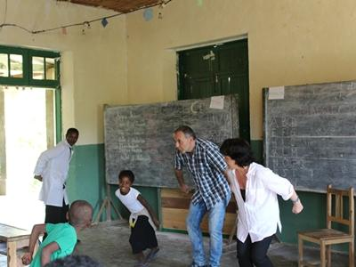 Children enjoy playing a game with a Projects Abroad Teaching volunteer at their school in Madagascar.
