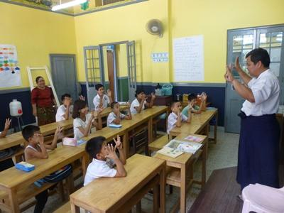 School children in Myanmar, Southeast Asia, participate in a class taught by a local teacher.