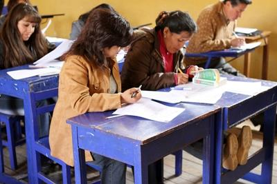 Volunteers teach adults on the English Teaching project in Peru, South America