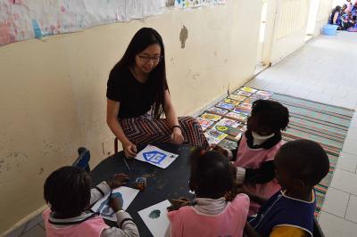 Kindergarten children listen to a Projects Abroad Teaching volunteer at a kindergarten in St Louis, Senegal.