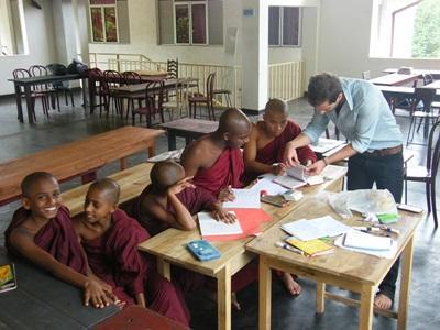 Volunteer teaches a class of monks in a school in Sri Lanka