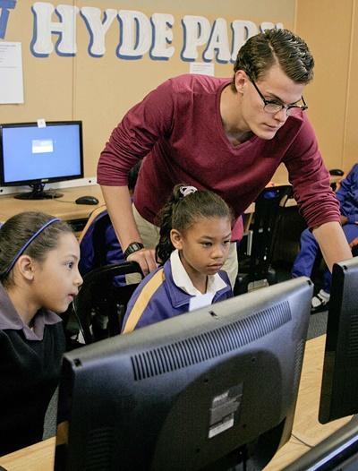 Volunteer teaches IT skills to children in schools in South Africa