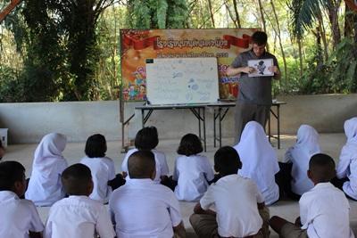 A class of Thai students listen to a volunteer teacher