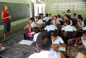 A volunteer teaches a French class at a high school in Costa Rica.