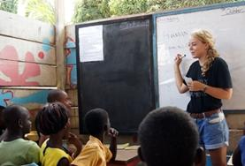 A volunteer teaches a French class at a school in Ghana.