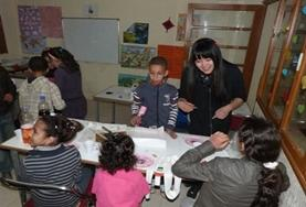 A volunteer helps young students learn and practice basic French in Morocco.