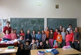 A French teaching volunteer with her class in Romania.