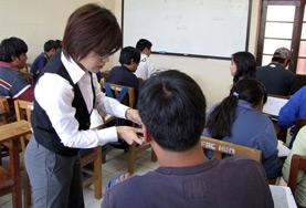 A Teaching volunteer works with her student in Bolivia.