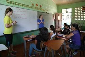 Two volunteers teach English at a school in Costa Rica during the summer vacation.