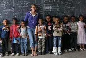A volunteer with a group of her youngest students at an Ethiopian school.
