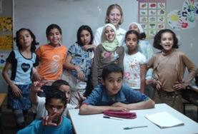A volunteer with her English Club students at a school in Morocco.