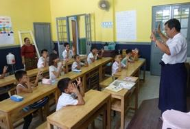 A local teacher leads an English class at a school in Myanmar.