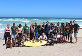 A group of volunteers and local children after an activity at a beach in South Africa.