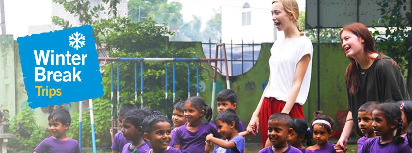 Two volunteers work with children in Sri Lanka during their winter break